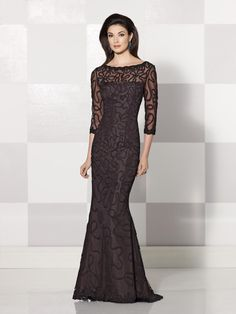 Illusion mermaid evening dress with allover swirled illusion pattern, illusion three-quarter length sleeves, illusion bateau neckline over a sweetheart bodice, sweep train, suitable as a mother of the bride dress or a formal gown.