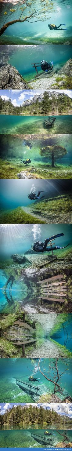 Austria's Green Lake in the Hochschwab Mountains is a hiking trail in the Winter. The snow melts in early Summer and creates a completely clear lake. The Lake has a grassy bottom, complete with underwater trails, park benches and bridges.