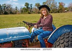 Google Image Result for http://image.shutterstock.com/display_pic_with_logo/6732/6732,1210284924,1/stock-photo-beautiful-mature-woman-driving-a-tractor-on-her-farm-12375373.jpg