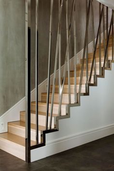 iron banister staircase-wooden staircase-apartment-interior design of apartment-apartment design