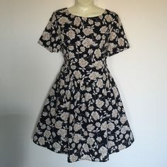 Floral party dress Dottie Couture NWT Black and gold. Floral. NWT. So cute. Strappy cross cross detailing in the back. From Dottie Couture Boutique. Price firm Dresses