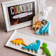 Rawr! It's a dinosaur themed baby shower, complete with directions on how to decorate cute dinosaur cookie favors.