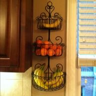 Put a gardening plant holder on the wall to keep your fruit in so it's not taking up room on the counter.
