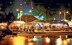 When visiting Barbados, you must go to Oistins Friday Night Fish Fry.