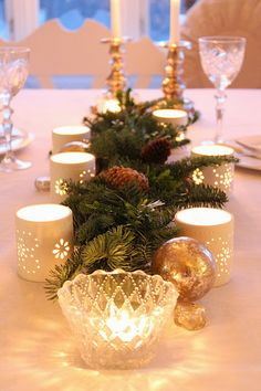 Beautiful tablescape for the winter! Christmas may be over, but that doesn't mean you can't still be festive