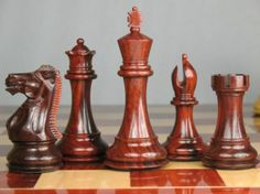 Triple Weighted Staunton Chess Set Bud Rose Wood 4Q. http://www.chessbazaar.com/chess-pieces/wooden-chess-pieces/triple-weighted-staunton-chess-set-bud-rose-wood-4q.html