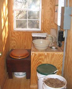 Simple composting toilet and wash basin and pitcher.