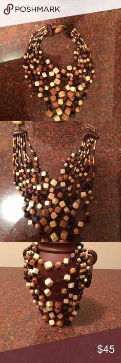Wooden bead necklaces Last call!!!Unique wooden multicolored necklace! Just pair it with a white shirt for an effortless casual chic!!! Jewelry Necklaces