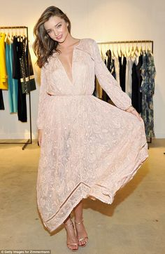 Miranda Kerr stunned at the Zimmermann Melrose Place flagship store opening on July 29, 2015 in Los Angeles, California