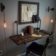 Industrial Suspended Iron Pipe & Solid Wood Wall by StyleOfAges