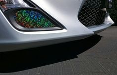 DIY fog light cover overlay for the Scion FRS made with black large scale iridescent fishscale pattern spandex, glued on cardboard, showing the sun light reflecting effect.