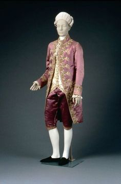 Men's formal suit, 1770's France, the Museum of Fine Arts, Boston    Coat: purple silk satin embroidered with polychrome silk yarns in chain stitch in floral motif at front line, vents, collar, cuffs pockets and flaps, buttons; stand-up collar, round cuffs with three buttons, padded upper chest, white silk satin lining. Breeches: purple silk satin, small fall, two fob and side pockets, brace buttons, embroidered knee bands and buttons, white fustian lining.