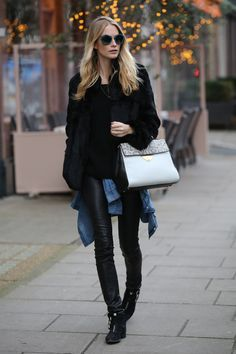 Poppy Delevingne looks effortlessly chic in this high/low mix of leather, fur and and a casual denim shirt tied around her waist.    - HarpersBAZAAR.com