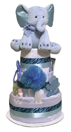 A plush elephant stuffed animal adorns our Blue Safari Diaper Cake, sure to delight the new baby and new parents alike! This beautiful baby shower centerpiece was specifically designed to match our Wild Safari and Sweet Safari baby shower decorating themes, and fits the bill perfectly.  Featuring dozens of high quality disposable diapers, 3 baby blankets, and several brand name baby care items, this hand-crafted item makes a thoughtful gift for the new Mom and Dad.  The entire diaper cake is ...