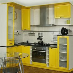 Small yellow kitchen ideas space saving kitchen furniture for small spaces white and yellow kitchen cabinets Kitchen Room Design, Modern Kitchen Design, Kitchen Interior, Kitchen Ideas, Kitchen Designs, Small Kitchen Set, Space Saving Kitchen, Colorful Kitchen Decor, Kitchen Colors