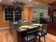 Browse kitchen island pictures from HGTV Remodels to see designs both large and small, in materials ranging from wood and tile to stainless steel.