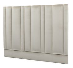 Theo Headboard - Asymmetrical fluting provides a striking design visual which can both enhance and blend in with most bedroom design schemes. Layers of padding provide a comfortable and indulgent recline while our selection of bed bases can exemplify the