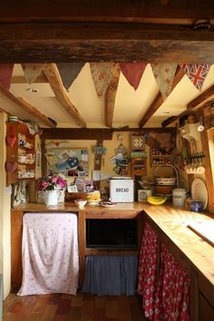 Bunting, fabric cabinets, wood beams 'The Enchanted Cottage' EH August 2012 Charlotte Coward-WIlliams