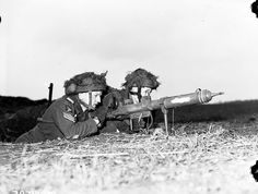 Private Johnson and Sergeant Fairborn of 1st Canadian Parachute Battalion with a PIAT Lembeck, Germany, 29 Mar 1945