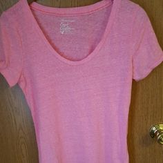 American Eagle shirt American Eagle short sleeved shirt. Worn but in excellent condition. Very pink. The color is off in the picture. American Eagle Outfitters Tops Tees - Short Sleeve