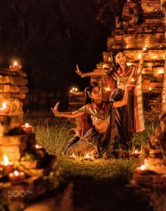 Thai Dancing Girl - Thai dancing girl in Ayutthaya style dress with candle at night