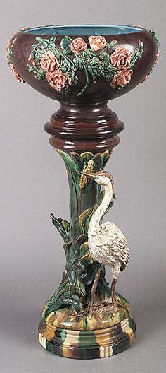 Majolica Jardiniere, the brown glazed bowl decorated with roses, the foliate pedestal shaded in earth tones and displaying a crane.