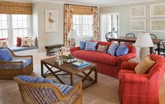Opposites attract! Orange & blue are opposites on the colors wheel, therefore they play well together! Remember this in developing a color scheme. Comfortable looking room.Laura Wilmerding Interiors - Chatham Living Room