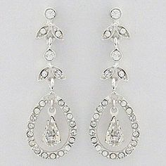 These vaguely remind me of the earrings Kate Middleton wore on her wedding day. Aren't they gorgeous?