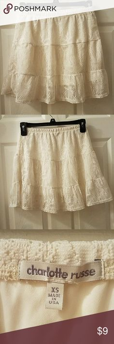 Charlotte Russe Skirt White lace skirt with underskirt.  Has little holes on either side to fit a belt.   * Will model upon request if my size! Charlotte Russe Skirts Midi