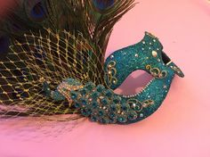 Feather peacock mask in turquoise blue and gold with Swarovski crystals - Ente And Gans Peacock Mask, Peacock Costume, Cute Costumes, Halloween Costumes, Peacock Birthday Party, Sandro, Mascarade Mask, Masquerade Party, Masquerade Masks