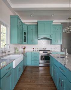 I'm telling you guys, my jaw literally dropped when I stumbled on this dreamy turquoise kitchen designed by Mikayla Valois of Riverhead Building Supply! The turquoise cabinets painted Sherwin…