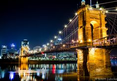 Early morning photo of the Roebling Suspension Bridge looking at the Cincinnati skyline and the Great American Ball Park. KY, USA
