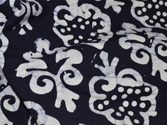 Bluish Black Batik Floral Print Cotton Fabric. Width of the fabric is 44 inches. You can use this fabric to make dresses, tops, Crafting, Drapery, Home Décor, Outdoor, Quilting, Sewing,...