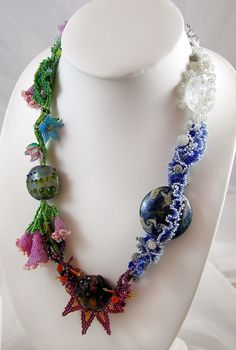 Collaboration with Wendy Bergamin who is a lampwork bead maker. The necklace is called 'Elixir of Life' and represents the four elements water, wind, fire and water.  - Sold