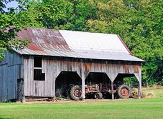 barn with tractors by quillus, via Flickr