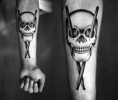 The Skull drumstick cross tattoo by kamill czapiga