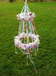 DIY:  Very creative butterfly chandelier!  Info includes how to, plus the materials list.  Great for a party or little girl's room.