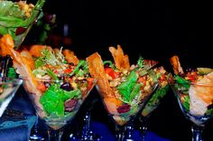 Individual appetizer salads in a martini glass. Unique hor' dourves really make a party complete.