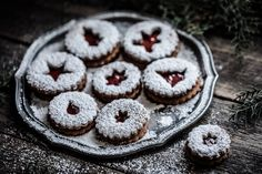 A simple gingerbread christmas cookie, stuffed with jam and cut into festival shapes. Dark Food Photography | Moody | Chiaroscuro | Food Photography | Food Styling | Food Props | Anisa Sabet | The Macadames