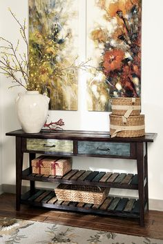 Bring a splash of subtle color and relaxed sensibility into your space with the Mestler sofa table. Whether you're going for an island-breeze vibe or a rustically refined look, this eclectic piece will fit right into your design scheme.
