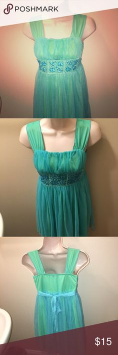 EUC My Michelle green dress w/blue overlay Size 12 Beautiful lime green dress with Tiffany blue overlay! Perfect Easter dress! 👗 Easter is early this year on 4/1☝️ Excellent Used Condition  Embellished waist Square Nevkline  Ties in back! My Michelle Dresses Formal