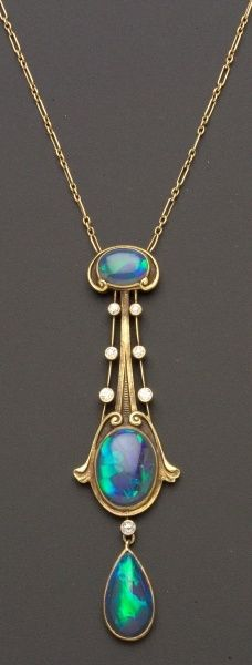 "Art Nouveau Black Opal and Diamond Pendant, The Brassler Company, Newark, New Jersey, set with three opal cabochons among scroll and knife-edge motifs, seven old European-cut diamond melee highlights, completed by delicate fancy link chain, 14kt gold mount, lg. 2 3/4, 16 in., maker's mark ""14B."""