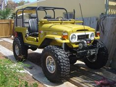Ours looked like this but it was red. 1973 FJ Cruiser with a custom roll cage that was my jungle gym as a kid.