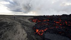 A man stands near a lava flow on Holuhraun, part of the larger Bardarbunga volcano system, northwest of the Dyngjujoekull glacier in Iceland, on September Photo credit: Eggert Johannesson/AP. Guide To Iceland, Lava Flow, Active Volcano, Cool Landscapes, Paris, New People, Cool Places To Visit, Alaska, World