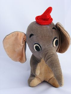 I had a stuffed elephant like this.took him to bed every night.My sister would hide him from me. Little Elephant, Cute Elephant, Disney Fun, Baby Disney, Antique Toys, Vintage Toys, Elephant Stuffed Animal, Disney Plush, Disney Merchandise