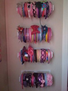 hung papertowel holders from the dollar store and then hotglued fabric … PERFECT! hung papertowel holders from the dollar store and then hotglued fabric on a roll of papertowels. I've seen fancier ones, but mine were super inexpensive! Diy Headband Holder, Headband Storage, Headband Organization, Organizing Hair Accessories, Girls Hair Accessories, Fashion Accessories, Ideas Para Organizar, Baby Girl Headbands, Room Organization