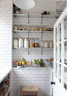 White subway tiles and open shelving