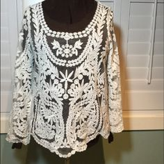 Sheer lace blouse Super cute, worn once. Sheer lace top, dress it up or wear a denim jacket over it. Has some stretch to it for comfort. Tops Blouses