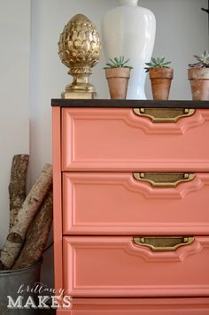Coral Crush, falling hard for this drab dresser turned fab with Behr Cool Lava. The Goldleaf handles go perfect for this dresser repurposed to a media console.  DecoRevolution loves #brittanymakes.