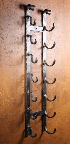 'Old World' Hand Forged Iron Wall Wine Rack. Comes in a 3' Section and Holds 7 Bottles. Custom Lengths and Headers Available Upon Request. These are Made to Order, Please Allow 2 - 4 Weeks. Price Brea